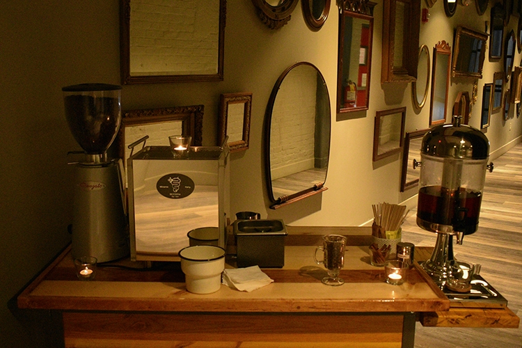 Espresso bar setup in a room with mirrors
